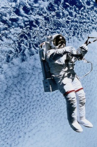 Picture showing an astronaut floating in space above Earth