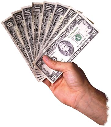 Picture of a hand holding several twenty dollar bills